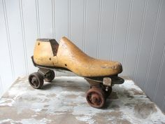 Vintage wooden shoe form cobblers last and rusty roller skate assemblage Shabby rustic industrial Farmhouse  Hi! This is an assembled piece of a vintage wooden shoe form or cobblers last and a rusty crusty vintage metal roller skate. Note they are attached. I like the sculptural industrial look of this as is, but you could alter it further. I like the folk art look of vintage industrial items used out of context. The shoe form is marked 6 1/2D and more text. It could hold a photo or sign…