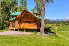 MLS# 21602465 | Absolutely charming log home situated on just under 25 acres with Logan Creek frontage. Nicely finished 2 bedroom, 1 bath, 1158 sq ft log cabin with wrap around deck for watching wildlife and taking in the mountain views. Private location, yet only 20 minutes to down town Whitefish. Great for a second home or year round living. Approx 440 feet of Logan Creek frontage. Equal Housing Opportunity. Info deemed reliable but not guaranteed by National Parks Realty. Listed by Jen…