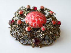 Czechoslovakia dimensional filigree brooch, pin, pendant. Brass, rhinestone, speckle glass. Art Deco.
