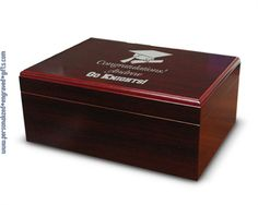 Did your friend just graduate from college with an MBA and land his first real job? Than welcome him to the working world with this cherry wooden humidor, engraved with his name, your congratulations and our artwork or your custom design.
