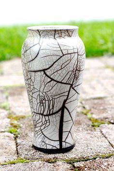 Ceramic vase from a raku workshop in North Carolina. Handmade and wheel thrown.