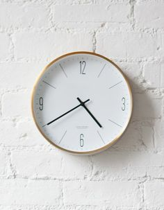 minimalist wall clock with gold-coloured edge