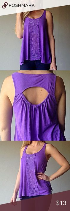 {Altar'd State} purple flowy bohemian tank Purple flowy bohemian tank with floral detailing down the middle and a small cut out in the back. Classy and simple with gorgeous little details that make it stand out. Pair this cute top with a white or cream cardigan on a fall day or high rise jeans shorts and gladiator during the summer. Only worn a couple of times with no flaws. Altar'd State Tops Tank Tops