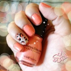 Coral nails with leopard accent