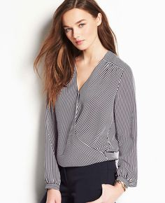 In a silhouette-slimming crossover style, this finely striped essential is a perfect canvas for the season's rich hues. V-neck with crossover front. Long sleeves with button closure. Front yoke. Shirred forward shoulder seams. Elasticized bubble hem.