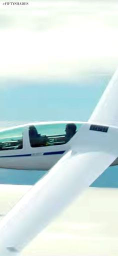 Official picture from the movie: Ana and Christian chase the dawn together in a glider. | Fifty Shades of Grey | In Theaters Valentine's Day