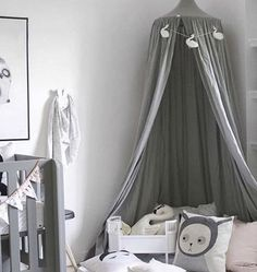 The Only Girl in the House Blog gives great interiors inspiration for grey nursery, gray nursery, baby room, baby bedroom, kids bedroom. Grey canopy and cot bed