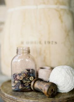 ...some of my favorites...yarn, spindle, twine and buttons...oh, and a like the old milk bottle, too.