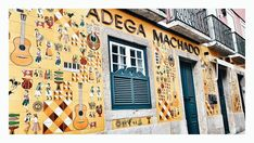 The Portuguese culture is shown on this wall-azulejos, traditional dances, fado music, sardines, wine, rooster..... #portugueseculture #chiado #lisbon #lisboa #lisbonworld #traveler #photography #vsco