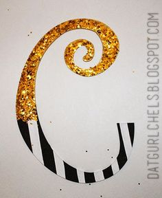 wood letter, painted and topped with glitter for my party. will be used in my art room later on.  painting craft project diy black and white stripes design dots gold swirl blog blogger
