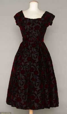 "Dior Cut Velvet Party Dress, 1954, Augusta Auctions -- Unlabeled, red w/ black outlined flowers cut to black net, faced w/ silk organza, curving neckline, fitted bodice, box-pleated skirt, black silk horsehair petticoat, 2 net w/ horsehair petticoats, black silk lining, B 34"", W 26"", L 43.5"", excellent. Brooklyn Museum"