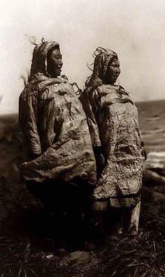 Here for your browsing pleasure is an extraordinary photo of Waterproof Eskimo Parkas. It was made in 1929 by Edward S. Curtis.    The photo documents Two Eskimo women, facing right, wearing knee-length animal skin parkas with hoods, looking out over a body of water.    We have compiled this collection of photos mainly to serve as a vital educational resource. Contact curator@old-picture.com.    Image ID# 22633B2A