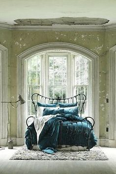 Blue bedding green wall