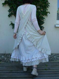 Pinafore layered over ruffled hemed skirt. I need this pattern !!!