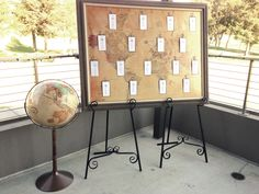 Framed World Map Seating Chart and Vintage Standing Globe. Visit AmericanVintageRentals.com to see more.