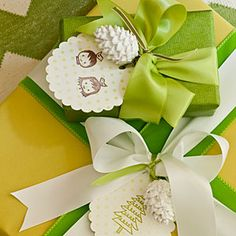 25 Stylish Gift Wrapping Ideas | Customize Presents | SouthernLiving.com - Extend the tree's color palette to the presents underneath by mixing cheery green-and-white paper with handmade tags and white ribbon.