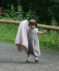 Suri Cruise, July 2007 Suri—daughter of Tom Cruise and Katie Holmes—takes her first steps at a park in Berlin.