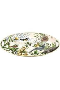 """This beautiful metal tray features the Into the Woods collection by Michel Design Works. The Into the Woods design is nature-inspired, with yellow flowers, birds, and butterflies. These charming metal trays are oval shaped and made of lightweight metal. It even has built-in handles for easy carrying. It is practical to use, easy to store, and always beautiful. It is a nice addition to your entertaining events, whether used indoors or outside.    Dimensions:16.3"""" long by 12.8"""" wide and is…"""