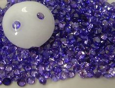 2mm VIOLET CZs - pkg of 20 Perfect for Lampwork Beads, Polymer Clay or PMC. $3.00, via Etsy.