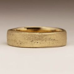 Rustic Wedding Ring. This wide flat ring makes for an excellent statement piece for both men and women, a wonderful present for oneself or someone special, or even as a unique wedding band. The ring is cast with recycled 9ct yellow gold which has a lovely warm natural colour.