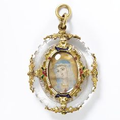 Rock crystal pendant mounted in enamelled gold, enclosing a miniature on vellum of the head and shoulders of the Virgin Mary, with relics of St. Tranquil set in the back, Spain, ca.1600.
