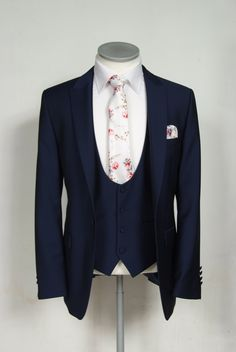 Our slim fit royal navy blue lounge suit works perfectly for a groom like this. A scoop waistcoat and a vintage white floral tie really make the groom look the part. The tie comes in a range of pastel colours too, so your groomsmen can accompany your look. A complete outfit to hire is only £159.50