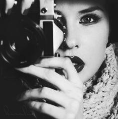 Camera, behind camera, woman, female, hands, eyes, scarf, portrait, history, photograph, photo b/w.