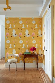 A rich marigold wallpaper is the first of several mesmerizing patterns that greet visitors upon entering