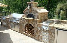#custom #stone #outdoor #kitchen