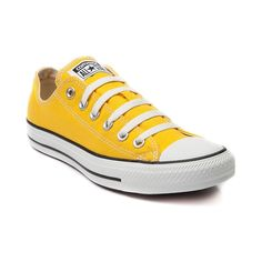 The All Star knows no bounds. From b-ball courts  to punk clubs. From skateparks to school yards. The Converse All Star has come a long way, and it's ready to take you even further. The original Old School never lets up. Bolded yellow--lemon canvas upper. <b>Available only at Journeys!</b><br> <br><b>Please note that this shoe runs a half size large.</b><br>