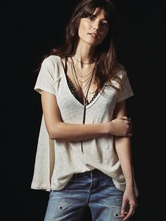 We The Free A Line Tee | In a linen-blend fabrication, this tee features exposed seaming and raw edges for a lived-in look. V-neckline and relaxed silhouette make for an easy, effortless fit.