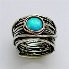 My birthstone and I love the earthy look of this.....