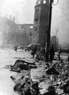 On the streets of Königsberg, East Prussia center, powerful German fortified area, taken by storm on April 6-9, 1945. In the foreground – dead German soldiers. The impressive building in the background – the Royal Castle. Right in the center – an octagonal tower Haberturm.     Location: Konigsberg, East Prussia, Germany Time taken: 04/10/1945