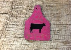 Pink crackle ear tag pendant with black cow silhouette. Includes a rhinestone pinch bail, not pictured.