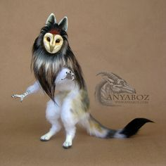 This tanuki has a tiger eye crystal heart and has a soft puffy faux fur coat. It's back stands about 6 inches tall. I really loved working on this guardian, and I love how the puffy fur worked for ...