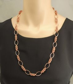 This versatile copper chain maille station necklace can be dressed up or dressed down for just about any occasion. It can be worn with casual clothes, business attire or that little black dress. Every station is articulated, so it's very fluid and will drape comfortably over any neckline or outfit. The entire necklace is made of solid copper. It is almost 28 inches long and is an endless strand, so there's no need to fuss with a clasp.  Every piece purchased from Silver Serenade comes in a…