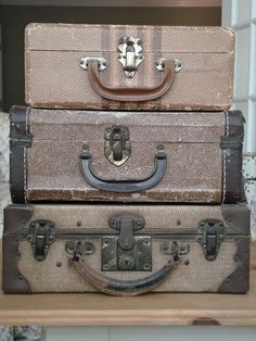 vintage suitcases. I want these but in colors with a piece of glass to turn into a nightstand.