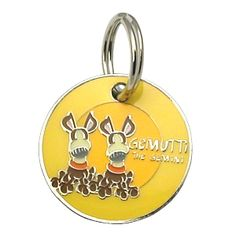 Dogoscope Tag- Gemutti the Gemini - May 21 to June 20      Personality characteristics :: alert, adaptable, friendly, curious, restless & intuitive.    Woof's your sign?    DogOscopes collar charms and pet ID tags feature colorful, canine representations of the twelve signs of the zodiac.
