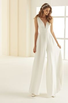 Celeste by Bianco is a beautiful alternative to a traditional wedding dress, with brilliant clean lines and a classic, but flirty neckline.