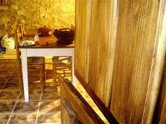 Cocina en vivienda rural rehabilitada vista desde el patio, Fontioso, Castilla, Spain.