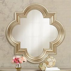 Accented with champagne burnishing, this ornamental quatrefoil wall mirror features an antique silver finish. 34 wide x 34 high x deep. Style # at Lamps Plus. Unique Mirrors, Contemporary Wall Mirrors, Round Mirrors, Traditional Mirrors, Mirror Lamp, Quatrefoil, Lamp Design, Decoration, Home Furnishings