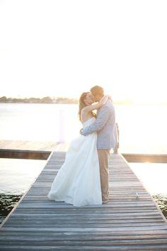 a kiss on the dock, photo by Shea Christine Photography