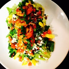 Shrimp salad with pineapples, pepitas, tomato and queso fresco