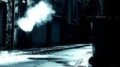 Steam coming from outlet in dirty deserted back alleyway during a rain shower, 2