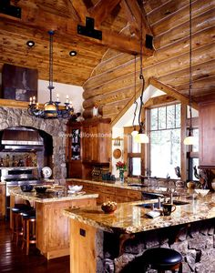 Love this log kitchen!! stone around range, and work space w/o appliance or water
