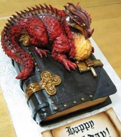 Beautiful Cake! Red dragon guarding this leather-bound book. Found on Cooking Panda's page.     https://scontent-mia1-1.xx.fbcdn.net/hphotos-xpt1/v/t1.0-9/11742801_1054567657901259_5937599142652515612_n.jpg?oh=83a491aed5aaf3b24e18047da8a19b7d&oe=564E449D
