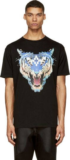 Short sleeve t-shirt in black. Crewneck collar. Multicolored tiger graphic printed at front. Tonal stitching.