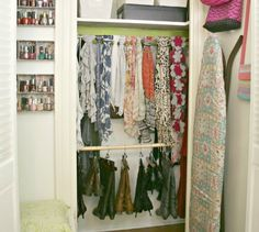 Create custom storage in your closet. Use tension rods to hang scarves and even your boots from. So much nicer than boot tops laying over on the floor.