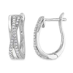 Transform everyday style into an elegant event. These gorgeous, sterling silver hoop earrings, adorned with round gleaming diamonds in a cris-cross, shared-prong setting, exude versatile style that can be worn by day and by night.
