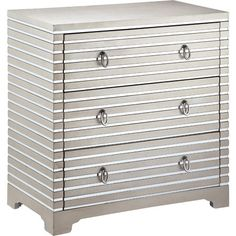 Three-drawer chest with a hand-painted champagne metallic finish, mirrored grooves, and ring pulls.    Product: Chest
